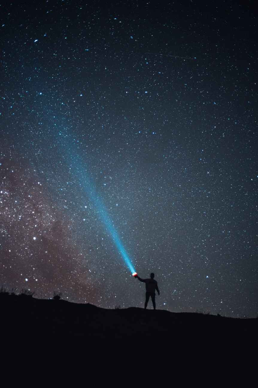 silhouette of person against mystery night sky